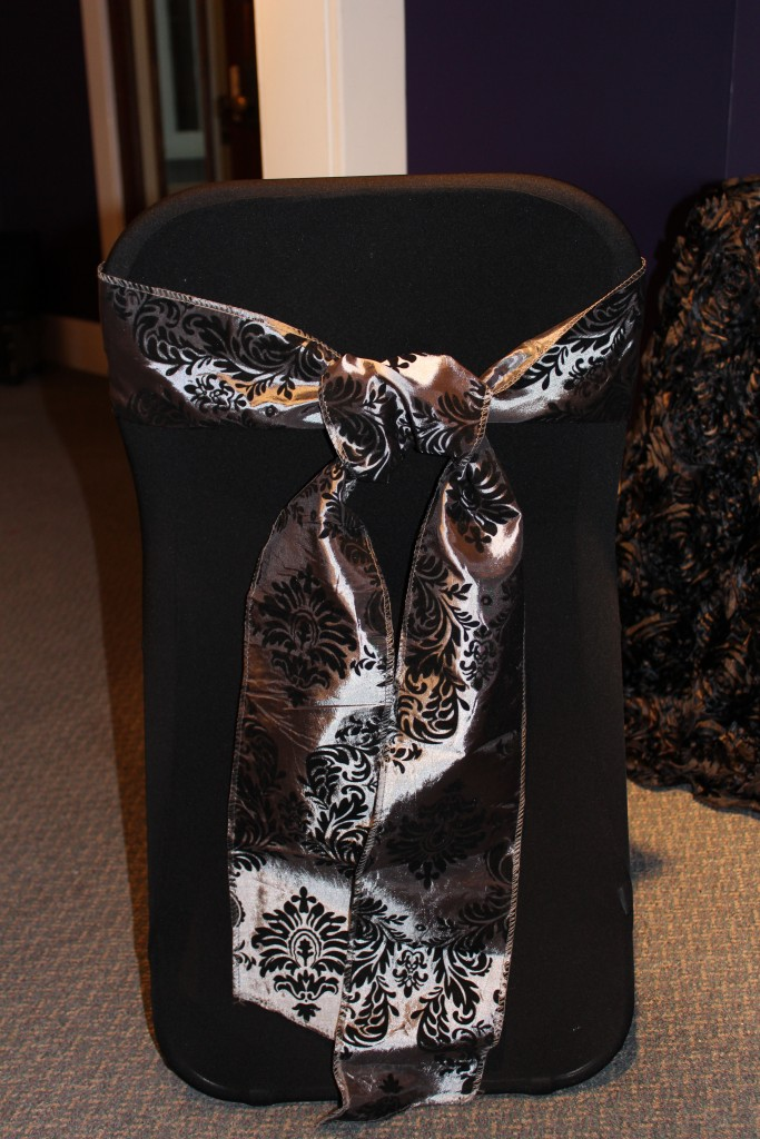 Back view of folding chair cover and grey flocked sash