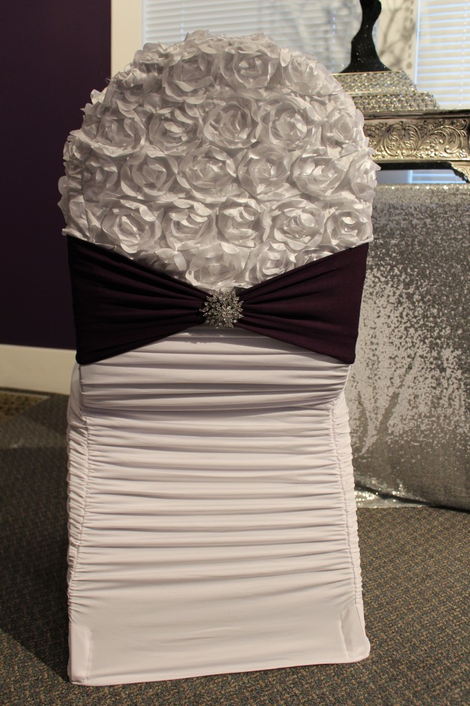 white ruched chair cover with white rosette chair cap and plum chair band